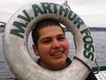 Troy aboard tug